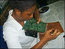 Woman working on a circuit board