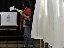 Hungarian woman casts her ballot in a polling station in Budapest,
