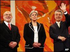 Austrian President Heinz Fischer, right, waves while Rudolf Gehring and Barbara Rosenkranz, from left, look on