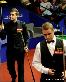 Mark Selby celebrates as Stephen Hendry exits the World Championship