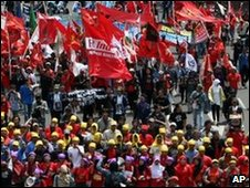 Indonesian protesters march during a rally marking the 100th day of President Yudhoyono's second term in Jakarta