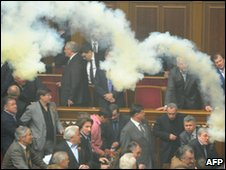 A smoke bomb is thrown during a parliament sitting in Kiev