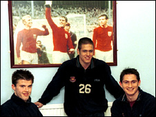 Young Michael Carrick. Joe Cole and Frank Lampard with a photo of World Cup heroes Bobby Moore, Geoff Hurst and Martin Peters