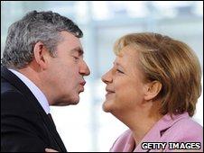 Gordon Brown zooming in to kiss Angela Merkel on the cheek ahead of a G20 preparatory meeting in Berlin on 22 February, 2009