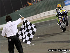 Valentino Rossi takes the chequered flag in Qatar