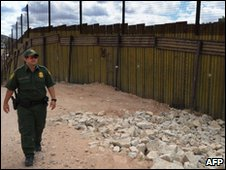 US Border Patrol officer by the border fence