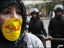 Protester in Cairo with riot police