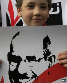 Boy with a picture of Mr Elbaradei