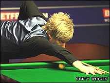Neil Robertson plays a shot in the World Championship final against Graeme Dott