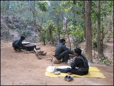 Maoist fighters cooking a meal in the forest in Jharkand state