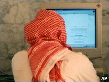 Saudi men talk and browse the internet at a hotel in Riyadh