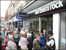 Customers queue outside a branch of the ailing Northern Rock building society, 2007