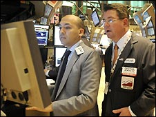 Traders work on the floor of the New York Stock Exchange (6 May)
