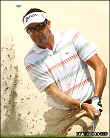 Robert Allenby hits out of a bunker