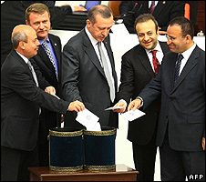 Turkish Prime Minister Recep Tayyip Erdogan (centre) and AKP allies voting
