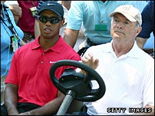 Tiger Woods is drien off the course by Joe Corless, head of security for the PGA Tour