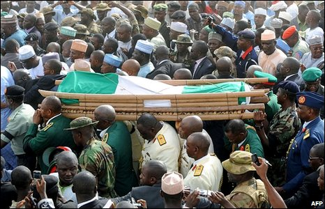 The casket containing the body of late Nigerian President Umaru Yar'Adua is carried from the Katsina Stadium to the cemetery, in Katsina, northern Nigeria