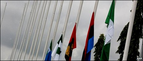 Flags are pictured at half mast in tribute to late Nigerian President Umaru Yar'Adua at Abuja airport
