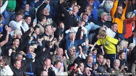 Cardiff City fans celebrate Peter Whittingham's goal