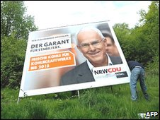 Election poster of NRW premier and CDU candidate Juergen Ruettgers is removed on 10/5/2010