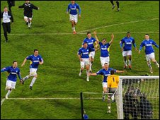 Cardiff rush to congratulate keeper David Marshall after their dramatic penalty shoot-out win