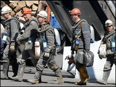 Russian miners after a rescue attempt at the Mezhdurechensk mine, 13 May 2010