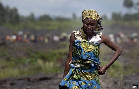 A Congolese woman cries while fleeing fighting in eastern Congo