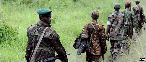 Rebel fighters from the National Congress for the Defence of the People (CNDP), under the direction of renegade army general Laurent Nkunda, walk in the bush near the north-east Congolese town of Rutshuru in the North Kivu area some 75 km north of Goma [file photo]