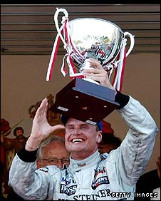 David Coulthard on the podium after winning the 2002 Monaco Grand Prix