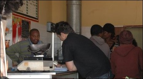 Lesego attends to customers at his shop in Phokeng Rustenburg