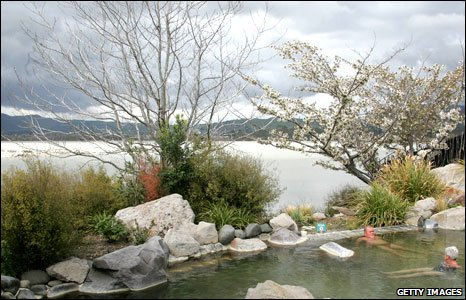 People bathing in the thermal pools at Polynesian Spas in Rotorua, New Zealand