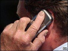 Mobile phone user in London - file image