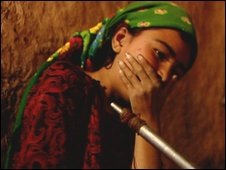 Afghan village girl Shasana smoking opium