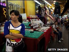 Thai woman waits for business at a stall
