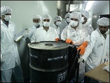 Iranian technicians mobve a container of radioactive uranium at the Isfahan plant (archive image)