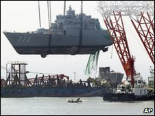 The South Korean vessel which sunk in March is lifted from the sea