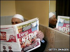 A man reads a newspaper in Albania