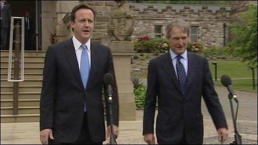 David Cameron and Owen Paterson outside Stormont Castle