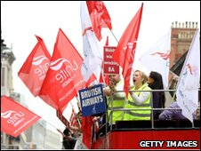 Unite members on open top bus in London