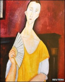 A reproduction of La Femme a l'Eventail (Woman with Fan) painted in 1919 by Amedeo Modigliani