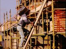 A hod carrier climbing a ladder