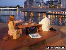 Couple in a cafe along the Seine