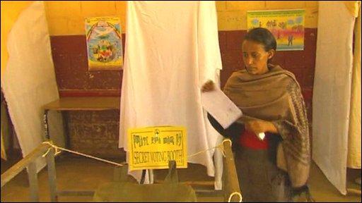A woman votes in Ethiopia