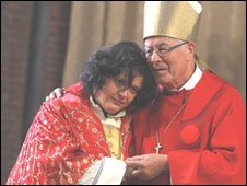 Maria Vittoria Longhitano (l) is embraced by Bishop Fritz-Rene Muller during a mass in which she was ordained