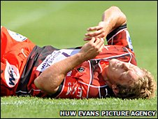 Jonny Wilkinson writhes in agony after taking a shot at goal