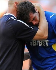 Joe Ledley consoled at the end of Cardiff City's 3-2 playoff final loss to Blackpool