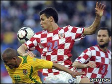 Croatia's Dejan Lovren challenges Wales' Rob Earnshaw in their friendly in Osijek