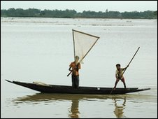 two lads in boat with fishing net