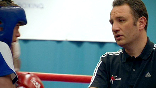 GB boxing chief Robert McCracken schools one of his young charges