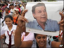 A supporter holds up a photo of Juan Manuel santos during a rally in northern Colombia on 20 May